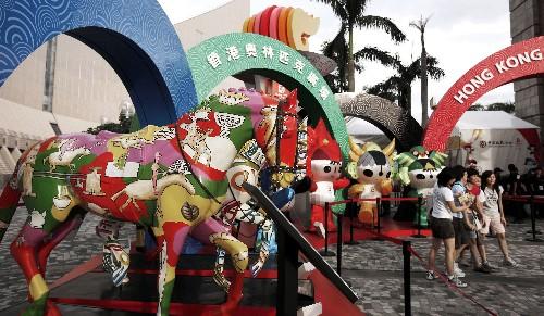 随着北京奥运会马术比赛即将开始,香港街头奥运气氛浓郁.