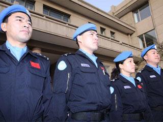 赴海地增援的四名中国维和警察启程