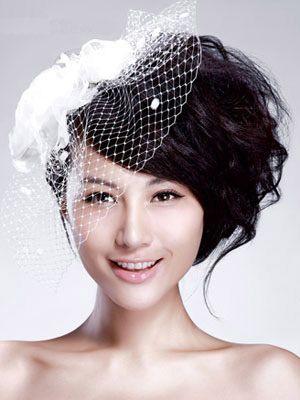 时尚妩媚 长发新娘的精致盘发图片