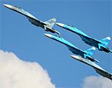 俄展示改进型苏-27战机新型卡-52直升机攻击机
