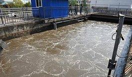 2月22日,在雲南紅塔體育中心內,活性污泥在反應池對污水進行降解處理,實現水資源再利用。中新社發 劉冉陽 攝