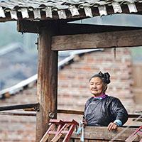 【图片故事】侗族歌师潘萨银花与她的大歌传习所