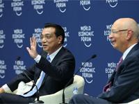 李克強同出席夏季達沃斯論壇的中外企業家代表對話交流