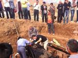 河南建築工地挖出古墓清代幹屍 身著官服保存完好[組圖]