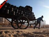 【圖片故事】舊城送煤工