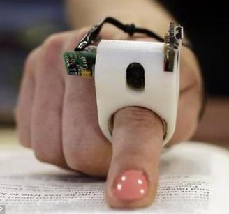极速10分快3官方-极速5分快3官方家发明手指阅读器 闭着眼睛也能读书