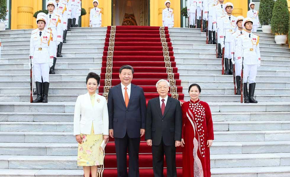 习近平出席越共中央总书记阮富仲举行的欢迎仪式