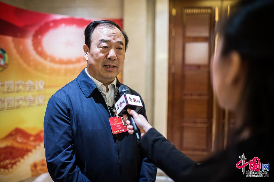 3月13日,全国人大代表、河北农业大学校长王志刚接受中国网记者的采访。中国网记者 郑亮 摄