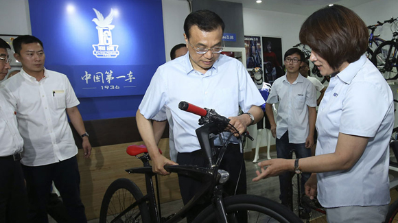 李克强在天津考察:愿为中国自行车做广告