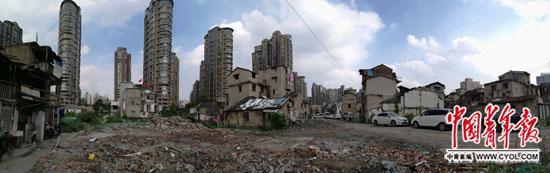 """上海闹市区""""最牛""""钉子户:房价逐月飙升_坐不住了_大香蕉新闻乐点彩票大发不时彩"""