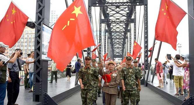 """老战士相聚鸭绿江畔迎""""八一"""""""