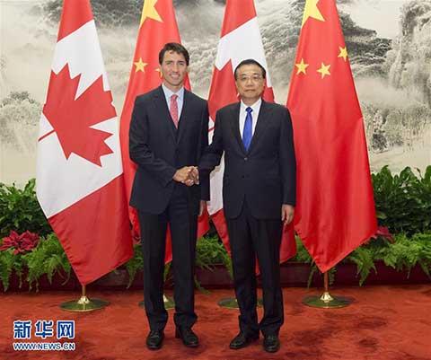 摄 -李克强同加拿大总理举行会谈