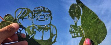 哈萨克艺术家化普通为神奇 树叶剪纸令人叫绝