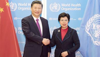 习近平访问世界卫生组织并会见陈冯富珍总干事