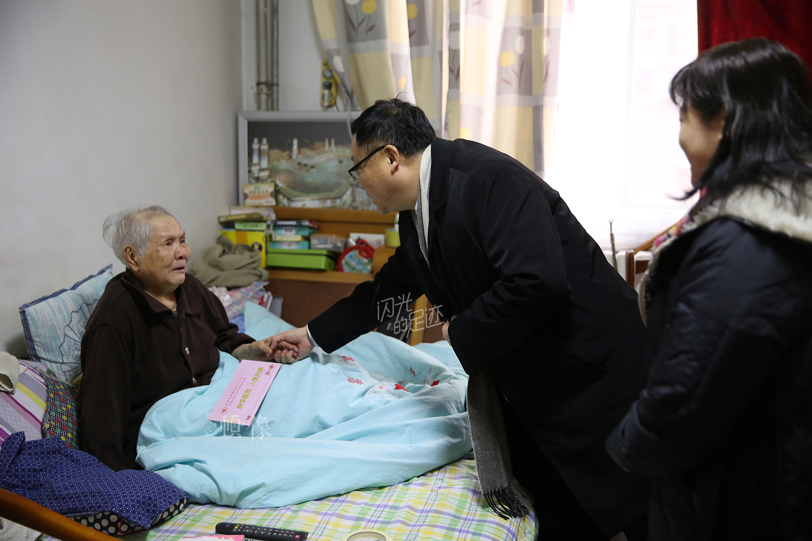2017年1月,北京市西城区红十字会慰问社区困难老人。(北京市西城区红十字会供图)