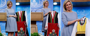 俄外交部美女发言人发布会上获赠裙子