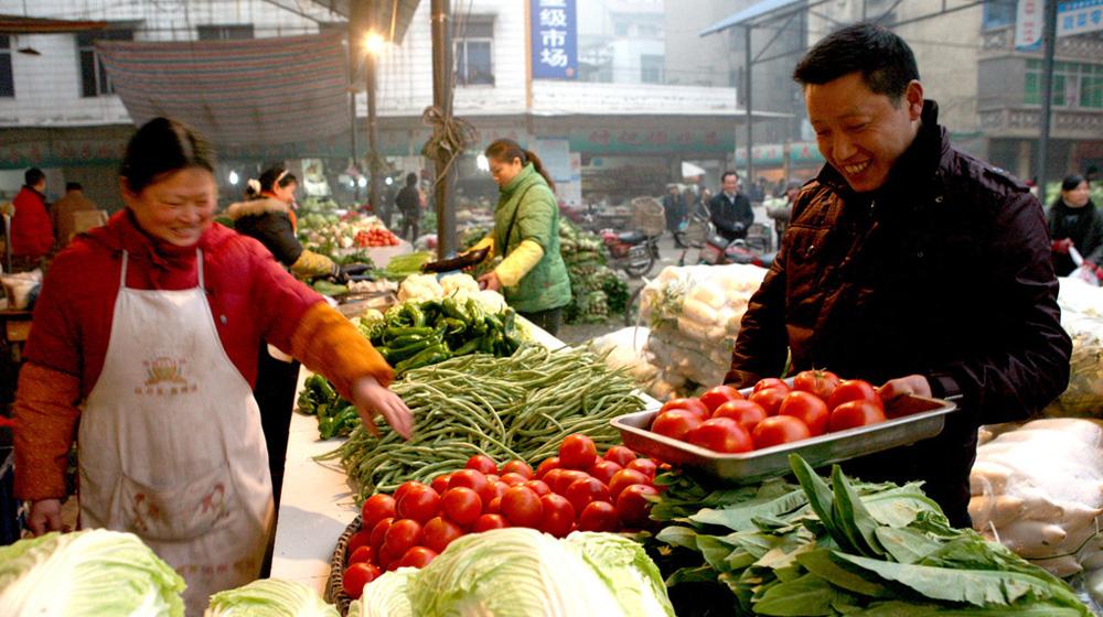 【帧像】国人买菜方式变革:从逛菜市场到送菜进家