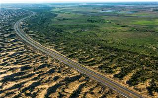 杨凯生:应当把沙漠治理纳入绿色金融的范畴