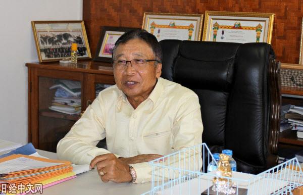老挝公共工程与运输部副部长拉塔纳玛尼·宽尼翁。(《日本经济新闻》网站)