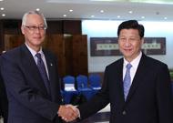 Le vice-président chinois Xi Jinping rencontre le ministre senior singapourien Goh Chok Tong