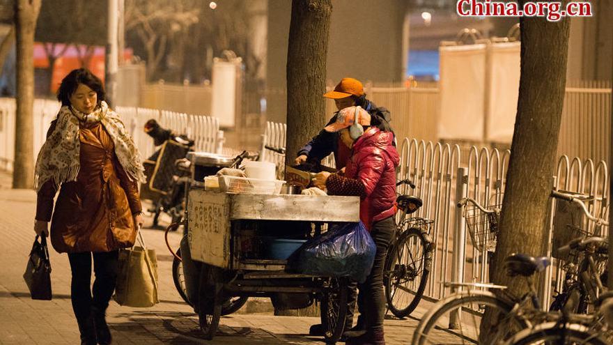 Instantanés de la vie à Beijing juste avant le lever du jour