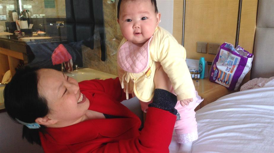 Pour participer à l'APN, une députée se rend avec son bébé à Beijing