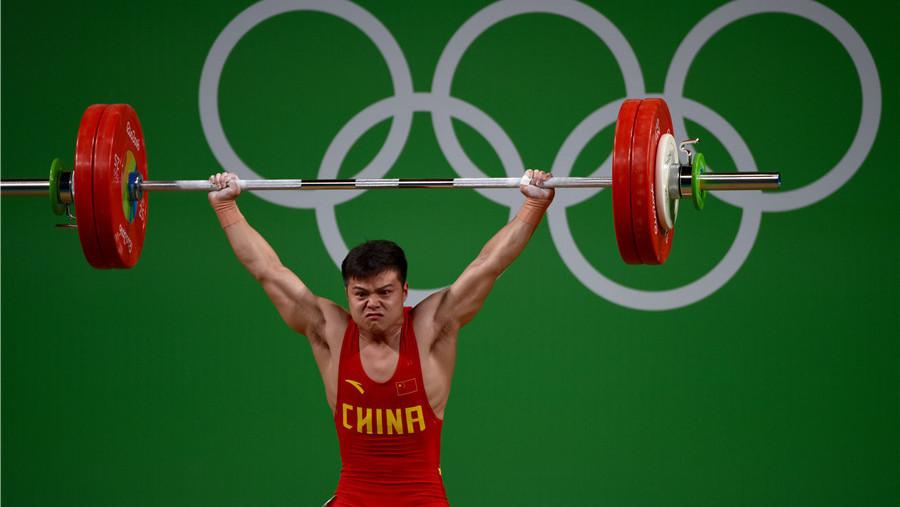 Médaille d'or et record du monde pour l'haltérophile chinois Long Qingquan