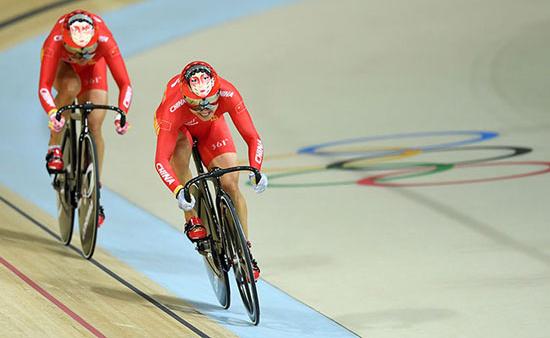 Première médaille d'or olympique de cyclisme pour l'équipe de Chine grâce à son entraîneur français