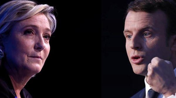 Le Pen se met en congé de la présidence du FN, Macron critiqué pour son dîner dans une brasserie