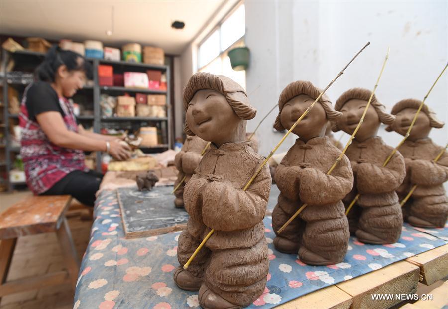 La sculpture sur argile Sanchizhai, dans le nord de la Chine