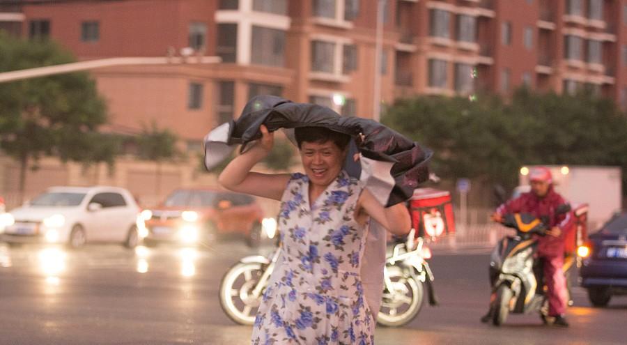 Des pluies abondantes apportent un répit à une ville de Beijing écrasée de chaleur