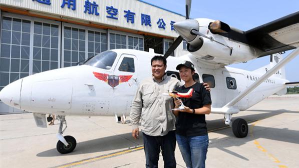 Un couple de Chinois qui a fait le tour du monde rencontre ses fans à Harbin