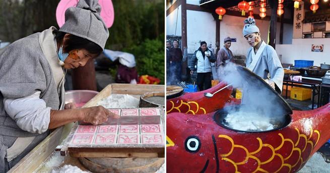 Köche bereiten Essen auf der 8. Fischmesse in Ostchina zu
