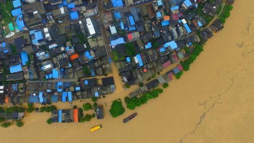 Durch die zunehmenden Pegelstände des Rong Jiang wird das Leben und die Sicherheit im Mündungsgebiet bedroht.