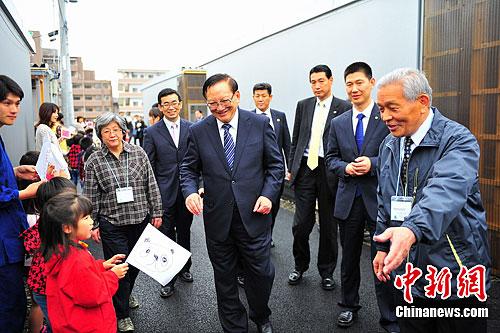 唐家セン会長が日本の被災地区住...