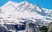 Заснеженные горы Мэйли