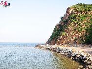 Гора Бицзяшань (кит.- подставка для кистей) расположена на западе провинции Ляонин Китая, обращена на залив Бохайвань и находится радом с портом Цзиньчжоу. Гора Бицзяшань является живописной местностью даосской культуры.