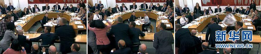 На фото: из кадров видно, что во время слушания по делу прослушки телефонных разговоров в британском парламенте Руперт Мердок был атакован мужчиной с тарелкой с пеной для бриться