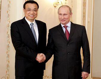 Ли Кэцян провел встречу с новоизбранным президентом, премьер-министром России В. Путиным