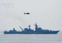 Совместные учения китайского противолодочного вертолёта «Чжи-9» и российского ракетного крейсера «Варяг»