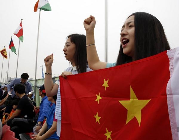 Азиатские игры: китайская девушка-волонтер в Инчхоне