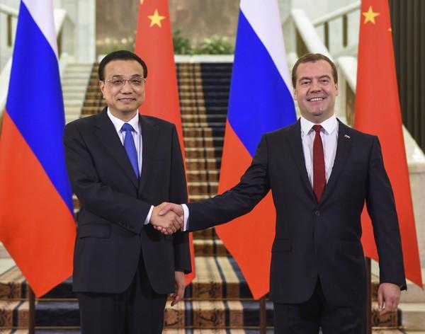 Премьер-министры Китая и России сопредседательствовали на 19-й регулярной встрече глав правительств