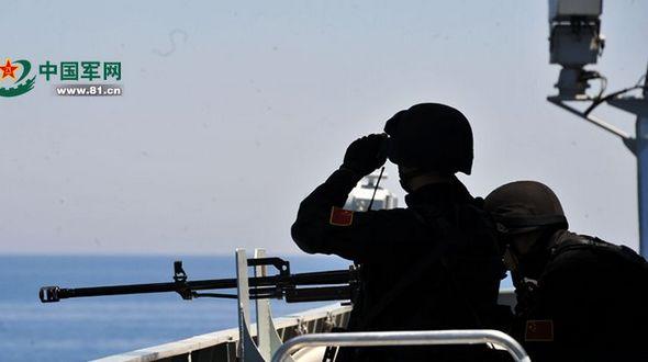 Боевые корабли Китая и России, участвующие в учениях ?Морское взаимодействие-2015? провели совместную оборонительную тренировку