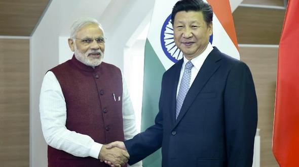 Си Цзиньпин встретился с премьер-министром Индии Н.Моди