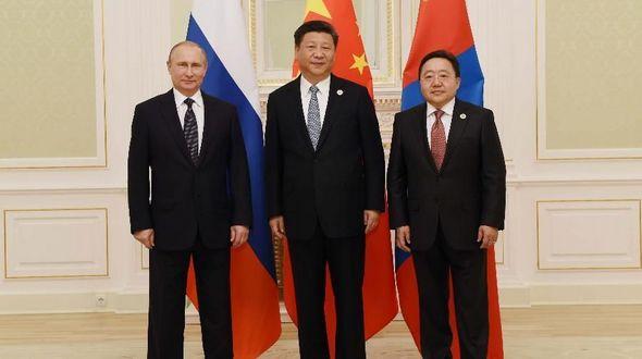 Си Цзиньпин председательствовал на третьей встрече глав Китая, России и Монголии