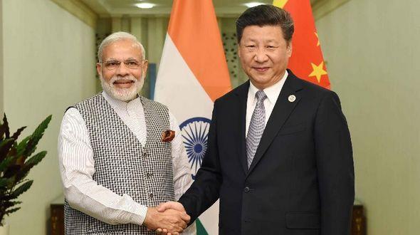 Си Цзиньпин встретился с премьер-министром Индии Н. Моди
