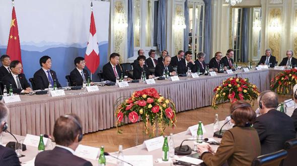 Си Цзиньпин и президент Швейцарии Д.Лойтхард встретились с представителями экономических кругов страны