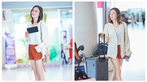Очаровательная актриса Цинь Лань появилась в аэропорту