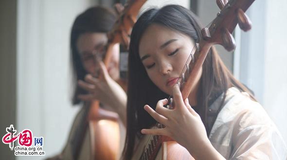Молодой исполнитель по игре на китайском национальном струнном музыкальном инструменте Жуань: дети – надежда наследия и развития культуры национальной музыки