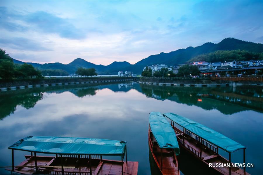 Деревня Сяцзян в провинции Чжэцзян -- путь 'зеленого' развития